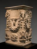A marble funerary altar inscribed for Mystes and her son Dorius