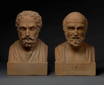 A pair of terracotta busts of Galen and Hippocrates