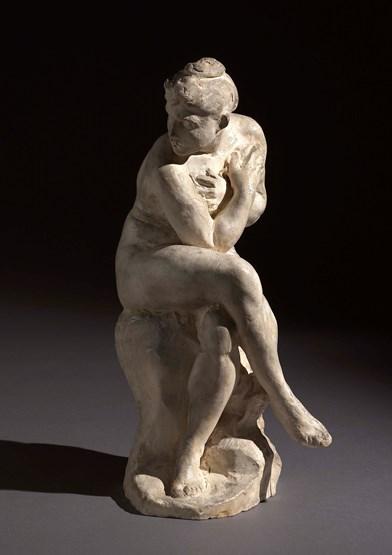 Femme surprise – a seated nude